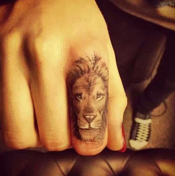 Rihanna cross tattoo on wrist