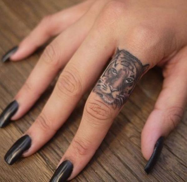 Tattoo Wedding Rings With Names 35 Good Tiger finger tattoo Cute