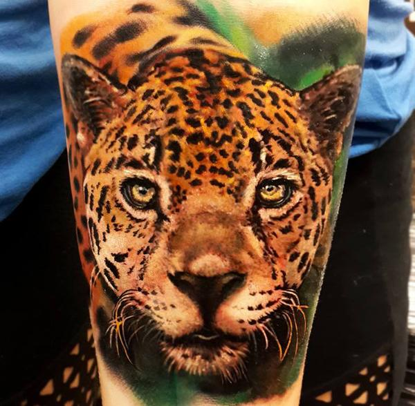 snow leopard tattoo arm