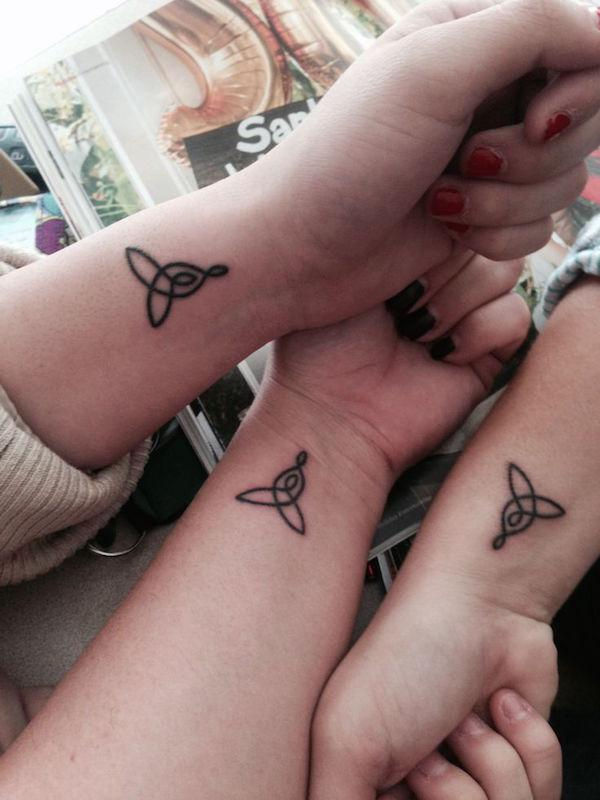 Triquetra knot tattoos for sisters