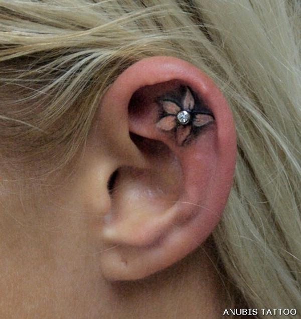 Ear tattoos pictures to pin on pinterest tattooskid for Atomic tattoo piercing prices