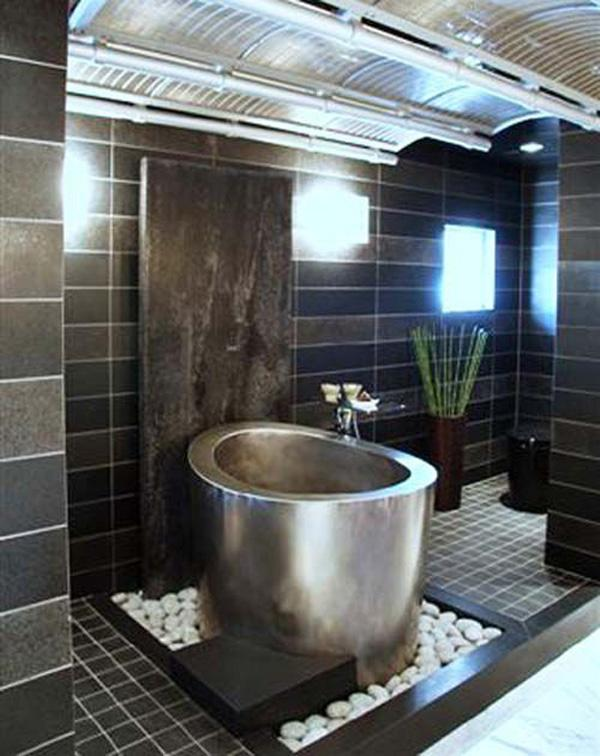 Metallic Compact Bathtub In A Tile And Stone Mount. The Combination Of  Tiles, ...