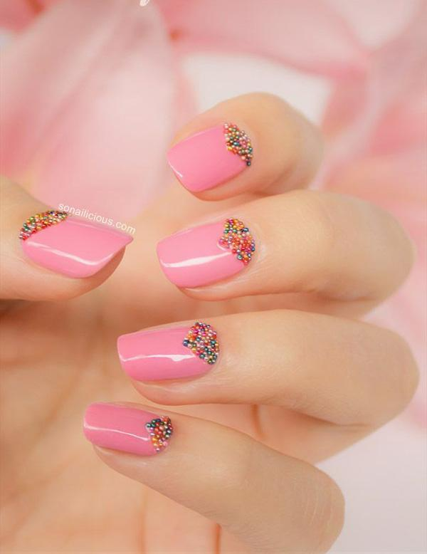 Pink nails with heart shaped diamonds