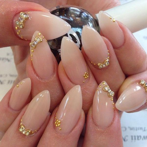 Simplicity is beauty as they always say. This is because the simpler you go, the more your true beauty shines. These stiletto nails truly speak for themselves. They do not need so much color, simply a plain nude polish and a couple of elegant gold acrylic and silver beads are enough to do the job.