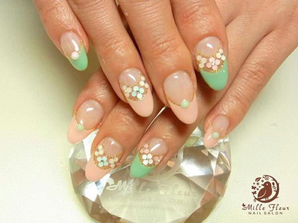 Flowers can make everything look pretty, especially the nails! This peach and green ensemble is great for proms, parties, debuts and weddings; events that have themes. If you are donning a sea green dress with peach accents then this nail art should be the design and color combination that you should go with.
