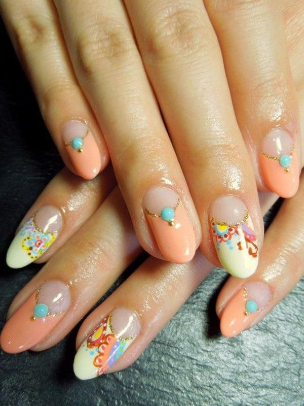 Go true with orange on this simple yet enjoyable looking nail art design. The flowers are playfully painted with multi colors making your eyes dance and jump from one color to another. The near peach plain color helps deviate your vision from the swirly designs of the flowers and rests your eyes until you look into another nail.