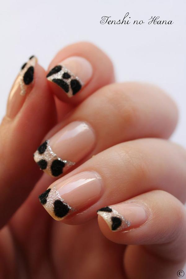 37 nude and black animal print nails