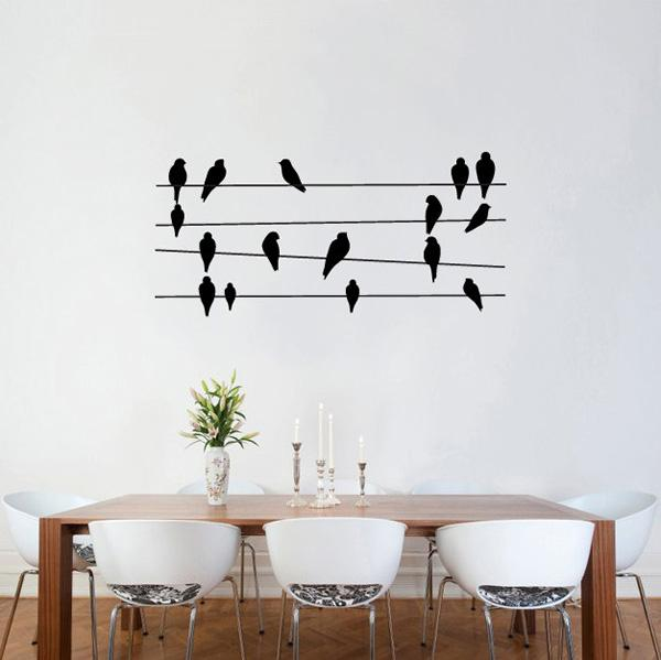 Beautiful The birds standing on wires which looks like music notes