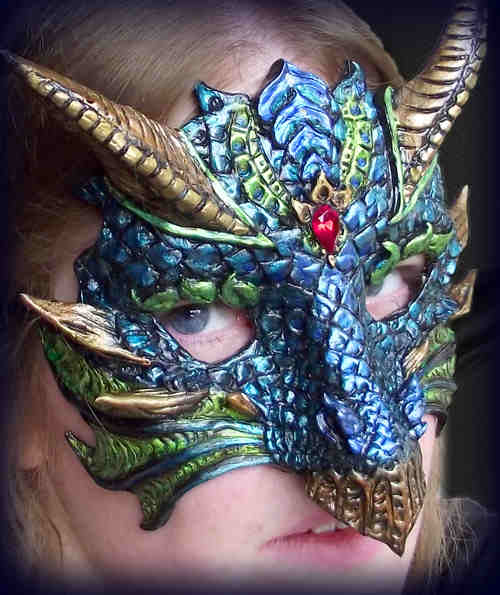 "BLUE GREEN DRAGON MASK This mask has semi-flexible horns. The mask itself is much lighter than it looks - about 4 ounces. With horns, it is roughly 7"" by 7"". It also has an artist's stamp on the back."