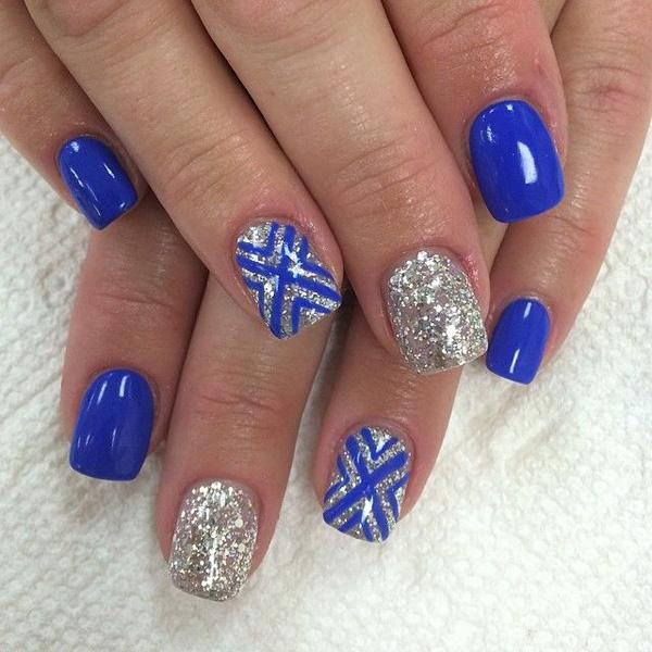 make way for this royal blue and silver glitter ensemble the nails are coated with - Simple Nail Design Ideas