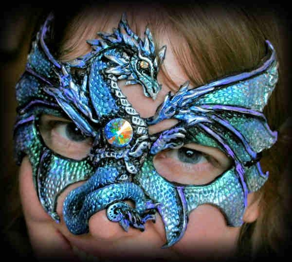 "ICE DRAGON MASK Color mixture: Blue, Purple, Silver & Teal Gem included - It is a clear jewel but it's got a tremendous amount of fire in it that sparkles with just every color. The mask is roughly 5 3/4"" wide by 4 1/2"" tall.  Handsculpted and handpainted."