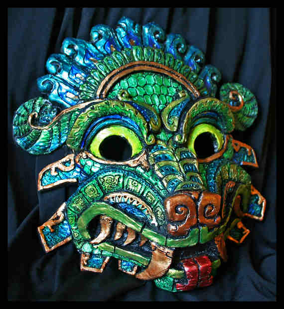 "QUETZALCOATL MOLDED MASK A molded mask of the Aztec god, Quetzalcoatl, which is loosely based on a stone carving of a feathered serpent from Teotihuacan with the artist adding her own style.  Roughly 10"" wide and 9.5"" tall. 6.5-7 inches across the eyes for fitting purposes. Each mask has an artist stamp on the back which is cast and painted individually as an order is placed."