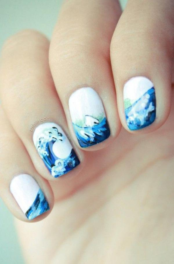 Cool and wavy summer nail art design. This rather simplistic design  combines white and blue ... - 65 Lovely Summer Nail Art Ideas Art And Design