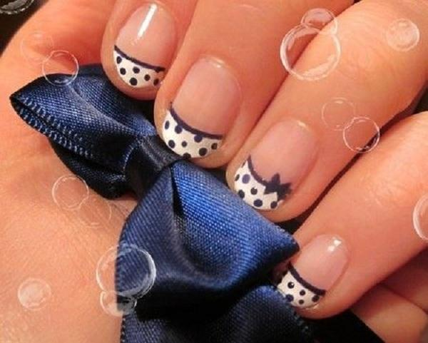 cute polka dots manicure with bow for short nails