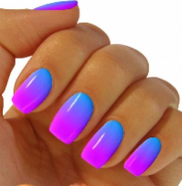 Glowing vibrant blue to purple gradient nail art.