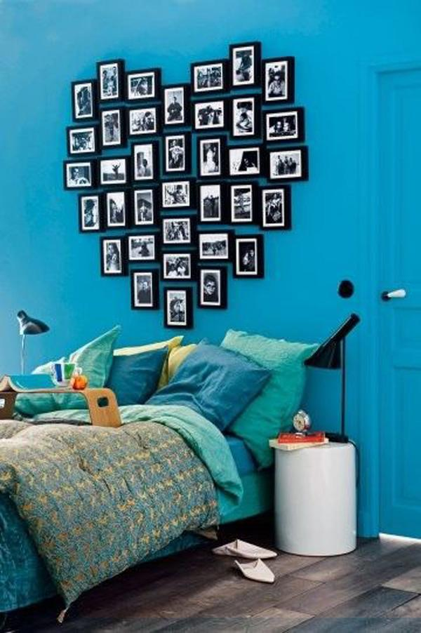 Turquoise bedroom with heart shaped headboard made out of picture frames