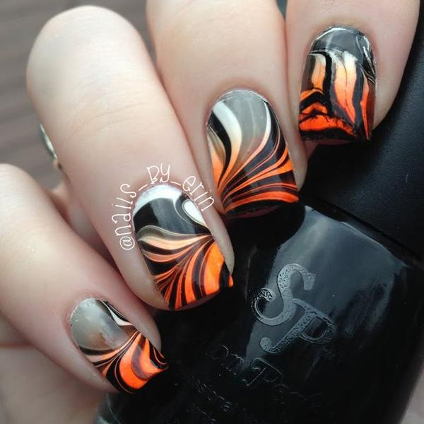Fiery and a sure stand out, this water marble nail art design plays around  with ... - 35 Water Marble Nail Art Designs Art And Design