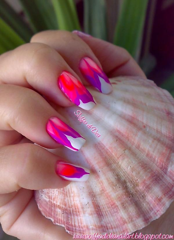 Flower patterned water marble nail art design using white, violet and pink nail polishes.