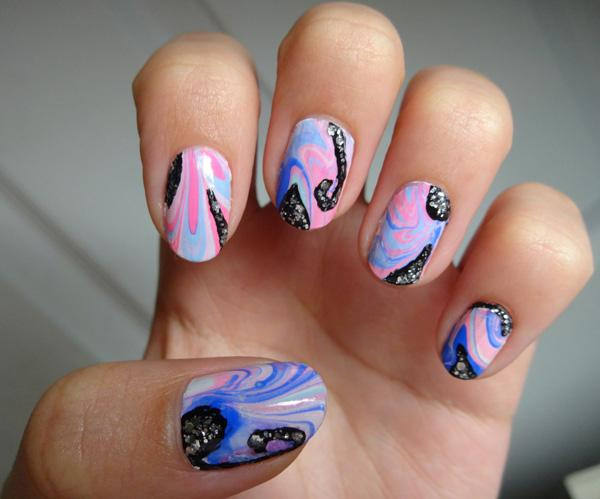 Add attitude to your marble nail art design by adding silver sparkles on top of the abstract pattern.