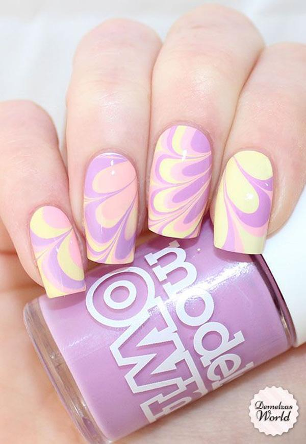 Light but classy water marble nail art design using baby pink, periwinkle and white colors.