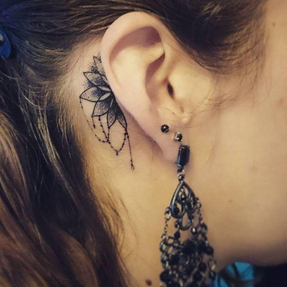 half mandala ear tattoo