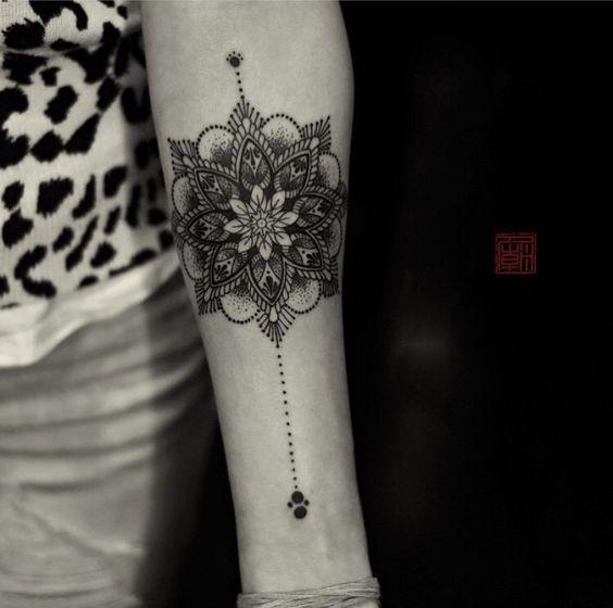 mandala forearm tattoo