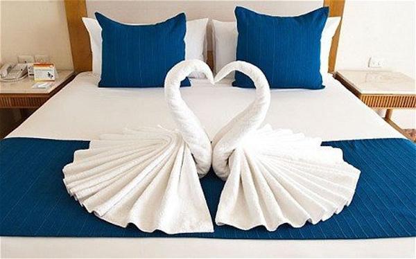 Bath towels folded to look like swans