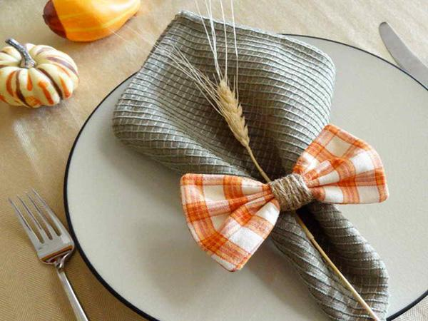 oversize rustic napkins bundled with wheat stalk and fruit make for