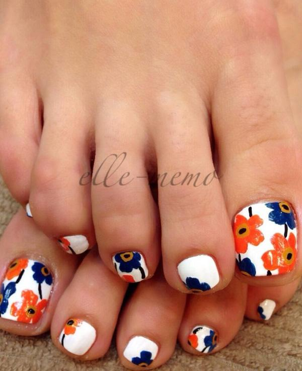 A cute and colorful flower inspired toenail art design. Using white as the  base coat ... - 50 Pretty Toenail Art Designs Art And Design