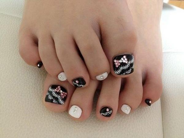 50 pretty toenail art designs art and design a lace themed toenail art design decorate your toenails with alternate matte black and white prinsesfo Gallery