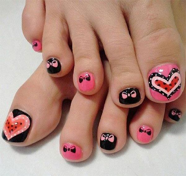 Heart and bow inspired toenail art design