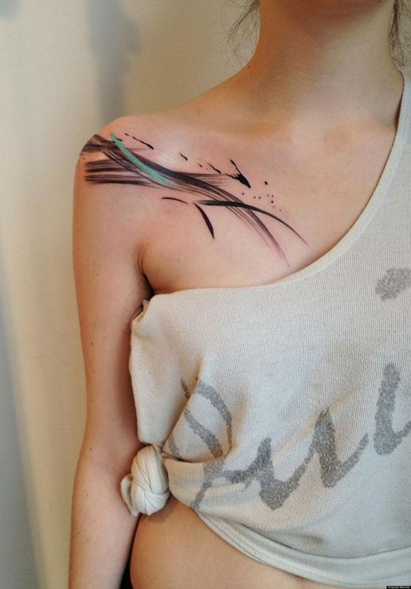 Abstract clavicle tattoo