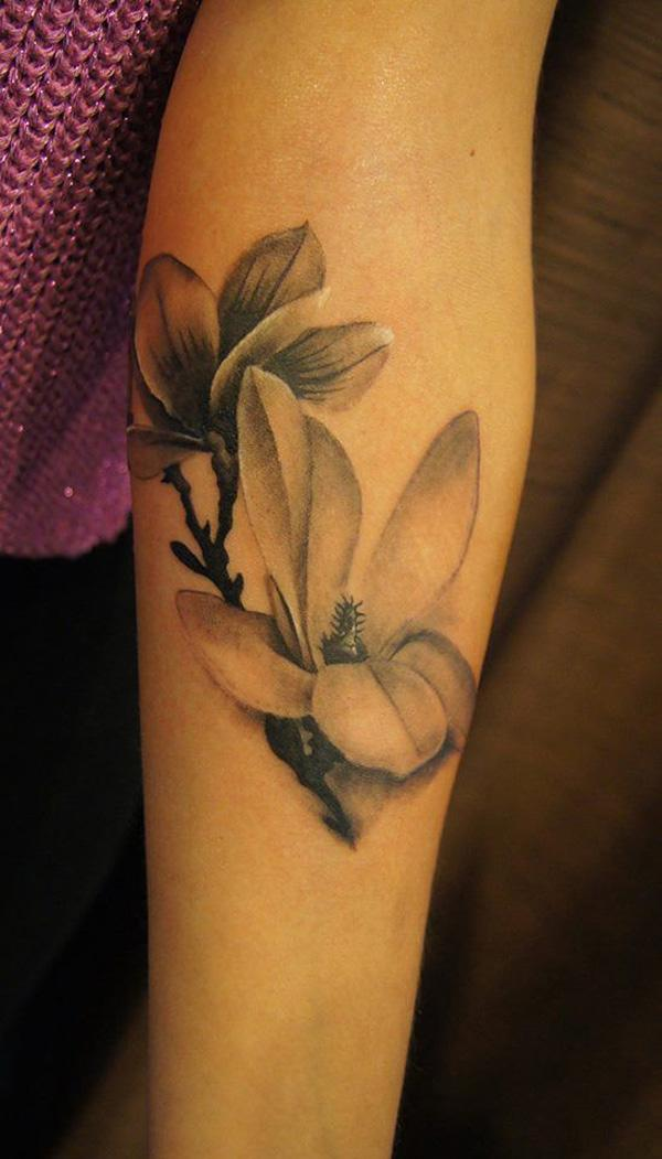 Black and white magnolia flower sleeve tattoo