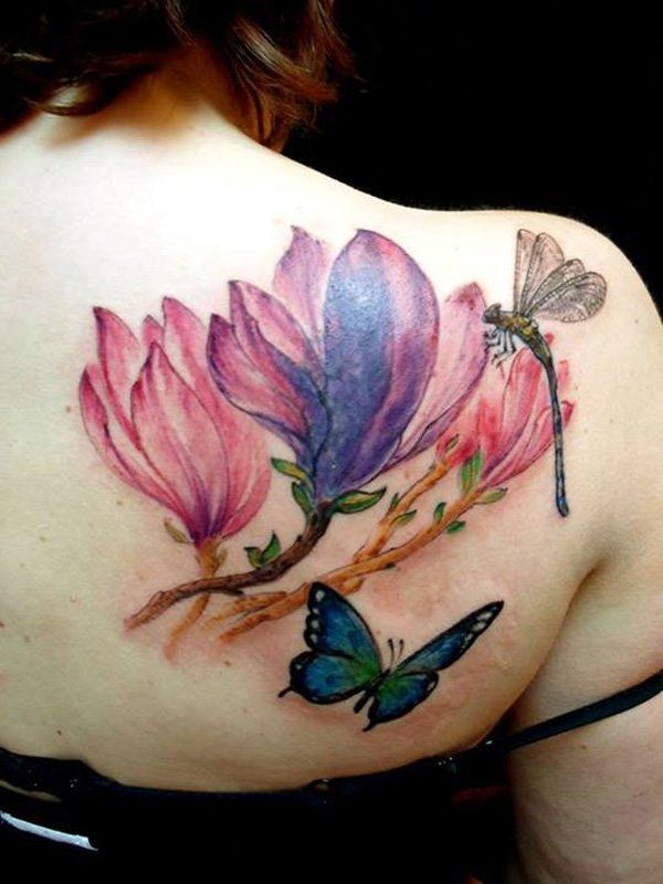 Colorful magnolia flower tattoo