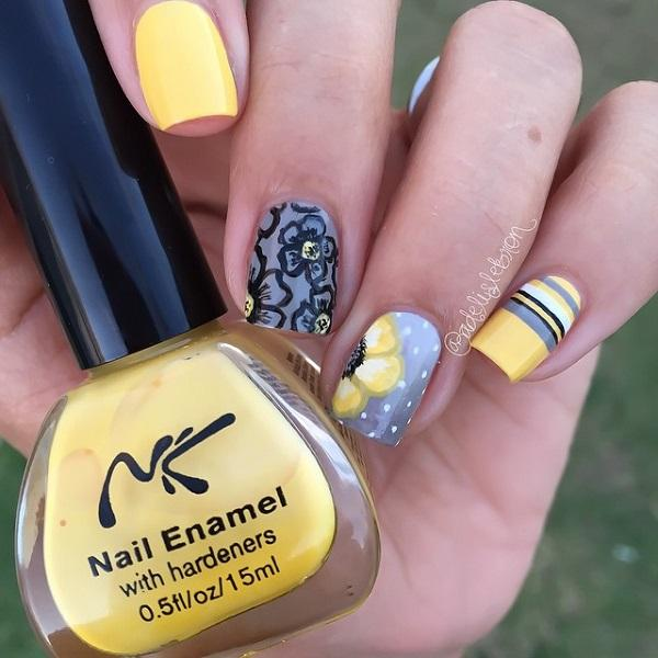 Flower themed fall nail art design in blue gray, white and yellow polish arranged as flowers, mini polka dots and alternating horizontal line colors.