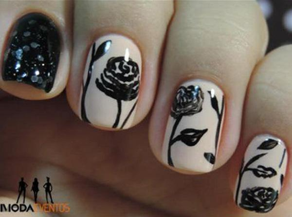 Paint silhouette fall flowers on your nails using a black polish for details and white as base color; add black sequins for effect.
