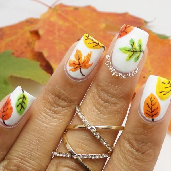 Add creativity to your nails with this multi colored leaf themed fall nail  art design. - 55 Seasonal Fall Nail Art Designs Art And Design