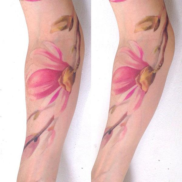 Magnolia tattoo on forearm