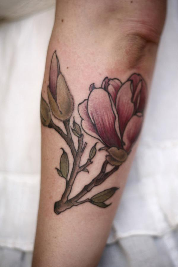 Magnolia tattoo on sleeve