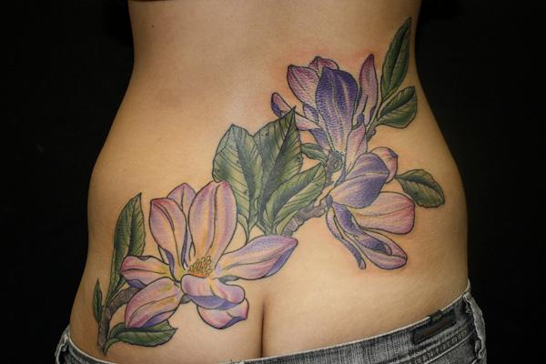 Magnolias tattoo on low back