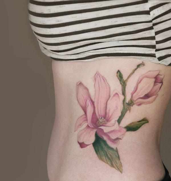 Magnolias tattoo on side