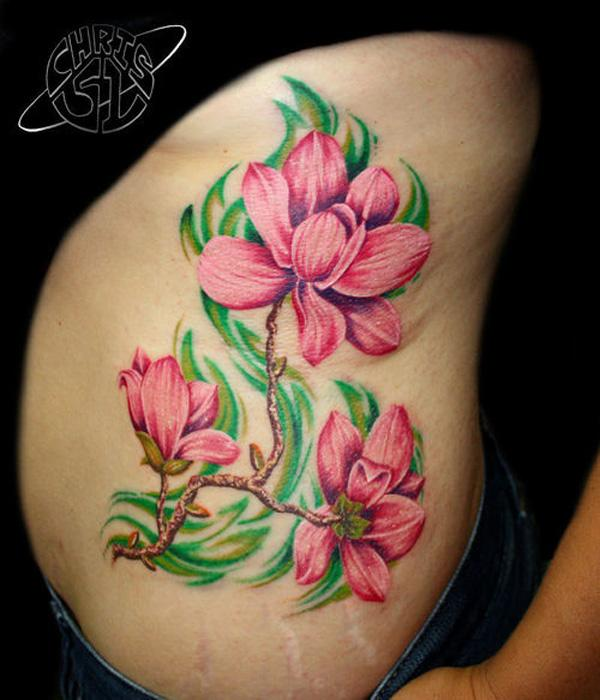 Pink magnolia flower tattoo