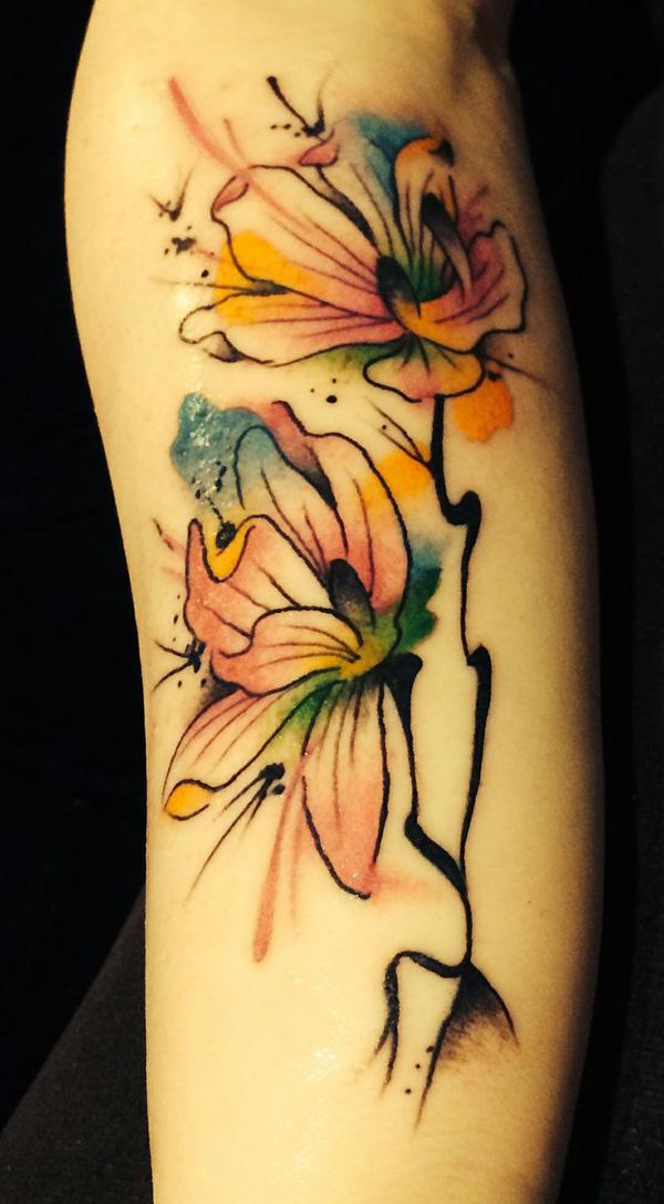 Water color magnolia tattoo