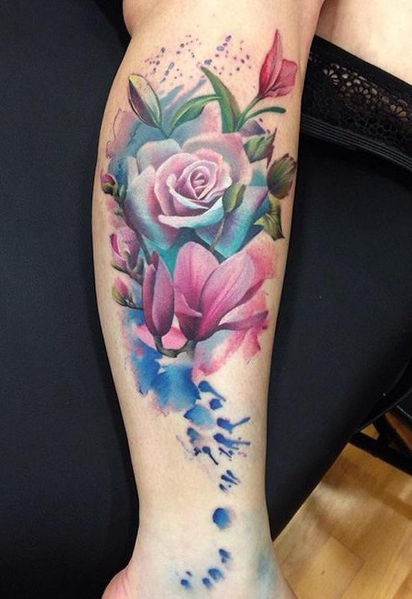 Watercolor magnolia and rose tattoo