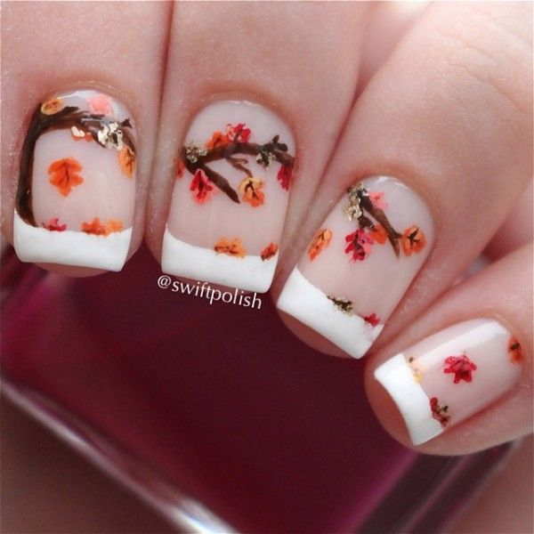 A wonderful French tip consisting of tree branches and falling leaves  perfect for the fall season ... - 55 Seasonal Fall Nail Art Designs Art And Design