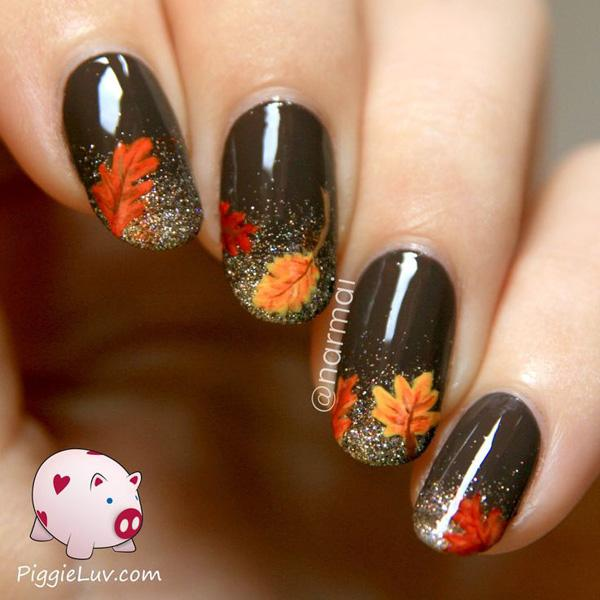 Fall leaves on a matte bronze nail polish sprinkled by silver dust on the  tips. - 55 Seasonal Fall Nail Art Designs Art And Design