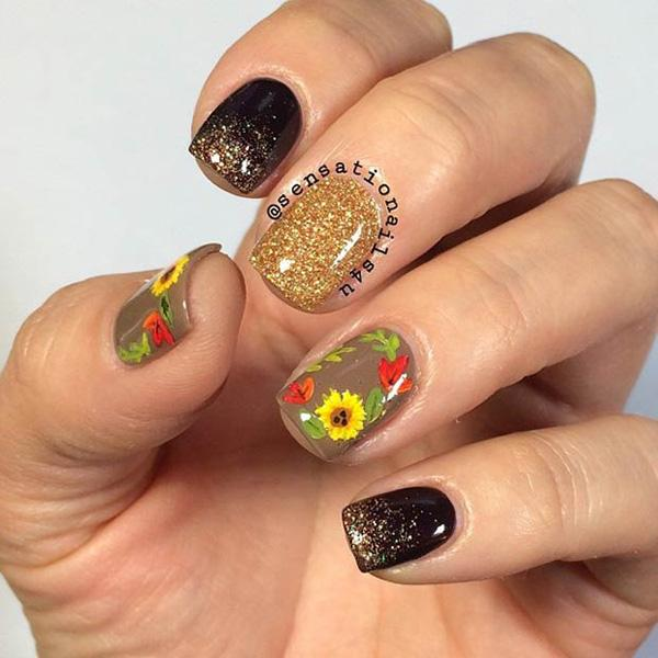 Glamorous bronze, gold and olive matte nails in sparkles adorned with fall leaves and flowers.