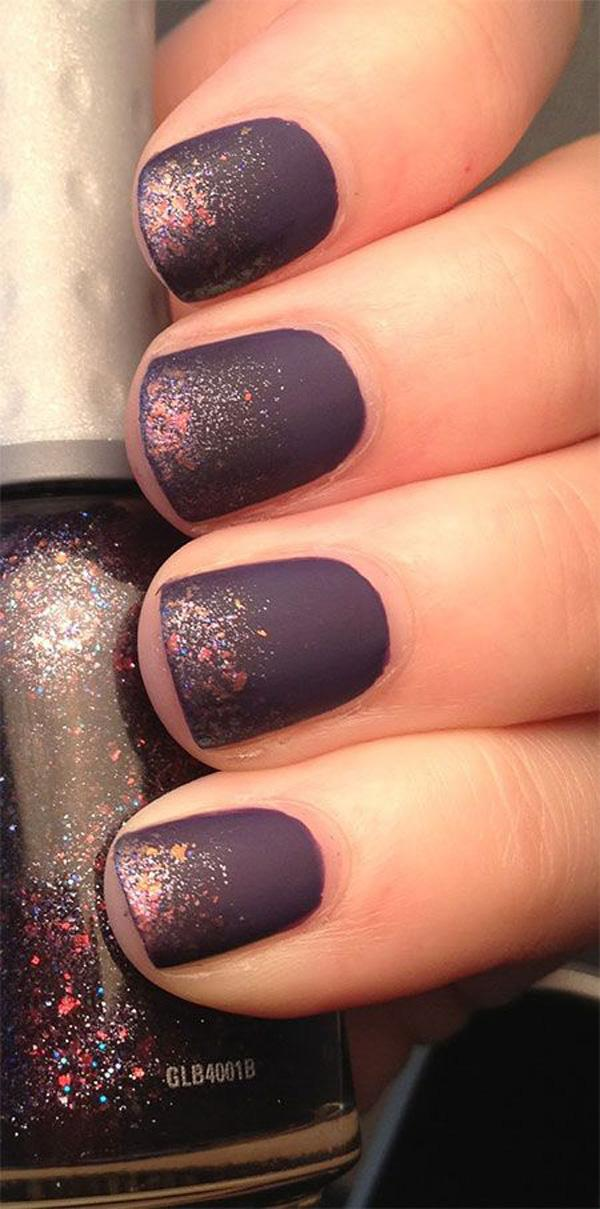 A violet matte polish adorned with multi colored dust as French tips.
