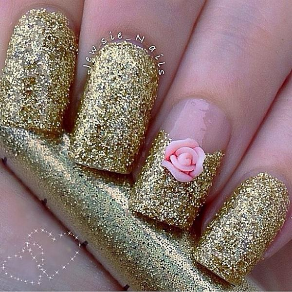 Ravishing in gold glitter nail art topped with a pink flower detail. - 60 Glitter Nail Art Designs Art And Design