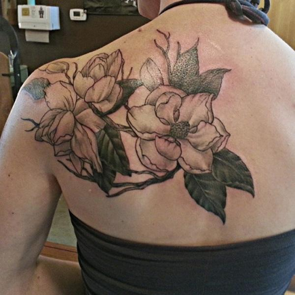 magnolia back tattoo for women